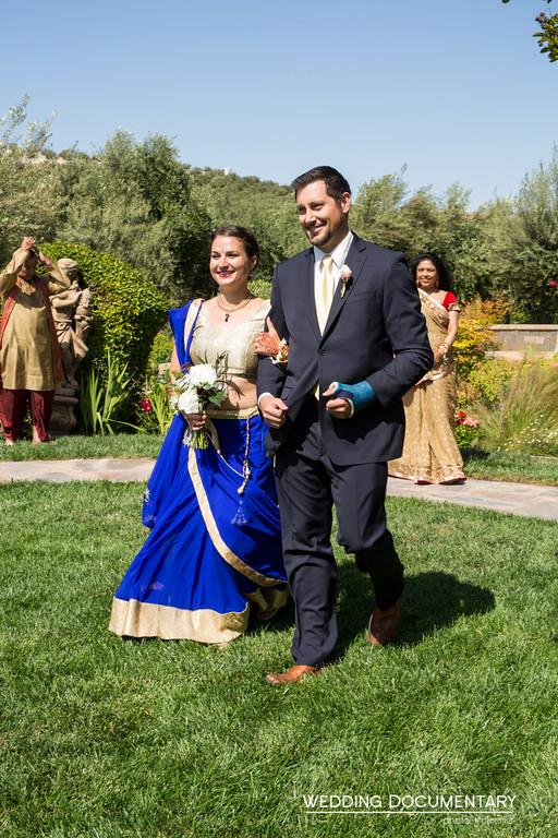 Bridesmaids and groomsmen entering the Hindu wedding ceremony.