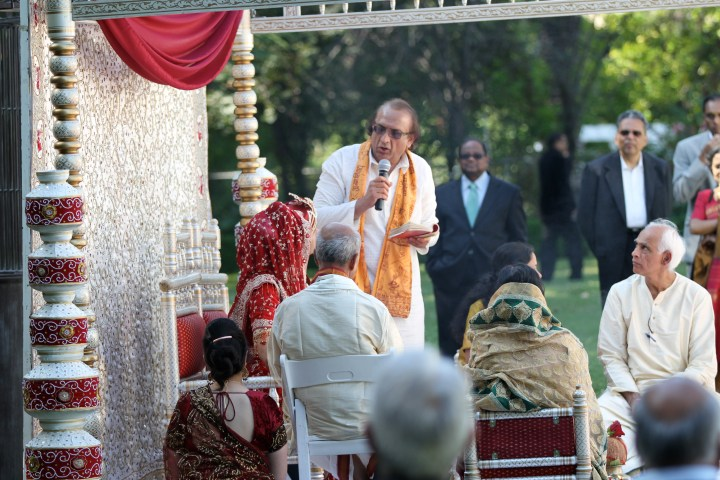 A Hindu priest performing a Hindu wedding ceremony.