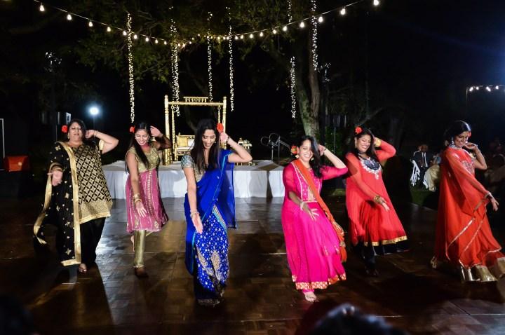 Rakhee-Amrish-gift-exchange-Indian-wedding-venue-photography-Greycard-Hindu-outdoor-dresses-bride-groom-vineyard-South-Asian-wedding-Bollywood-reception-all-girls-dance