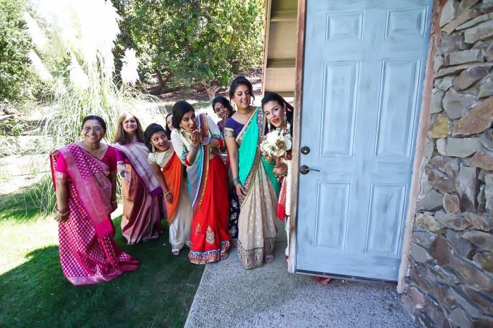 Rakhee-Amrish-gift-exchange-Indian-wedding-venue-photography-Greycard-Hindu-outdoor-dresses-bride-groom-vineyard-South-Asian-wedding-bride-bridesmaids-funny-photo