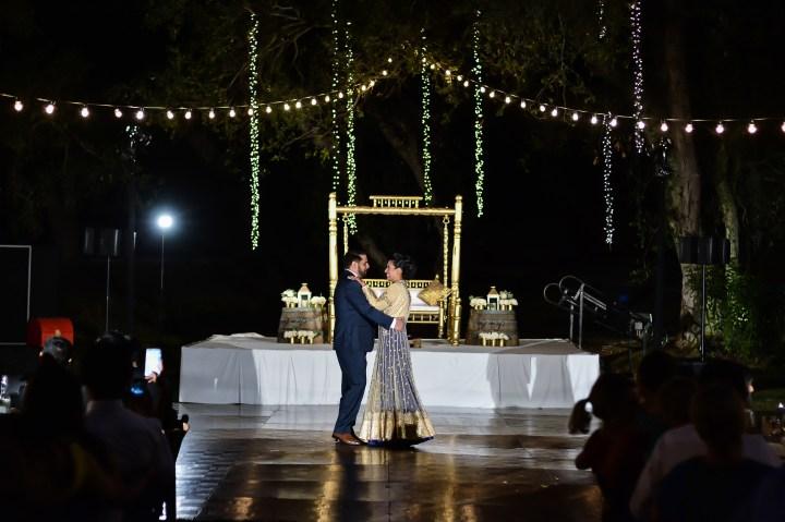 Rakhee-Amrish-gift-exchange-Indian-wedding-venue-photography-Greycard-Hindu-outdoor-dresses-bride-groom-vineyard-South-Asian-wedding-first-dance-swing
