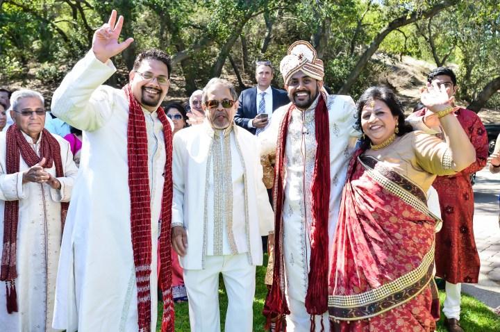 Rakhee-Amrish-gift-exchange-Indian-wedding-venue-photography-Greycard-Hindu-outdoor-dresses-bride-groom-vineyard-South-Asian-wedding-groom-family-friends