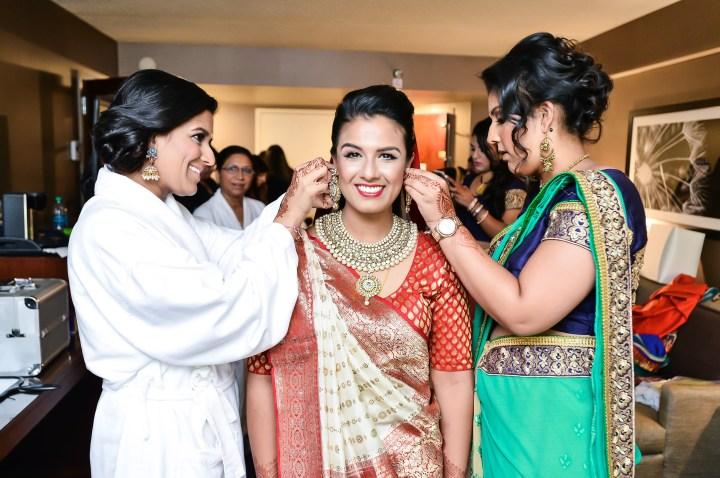 Rakhee-Amrish-gift-exchange-Indian-wedding-venue-photography-Greycard-Hindu-outdoor-dresses-getting-ready-makeup-hair