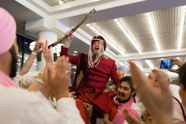 Canadian groom wearing a pagadi and sherwani during his baraat.