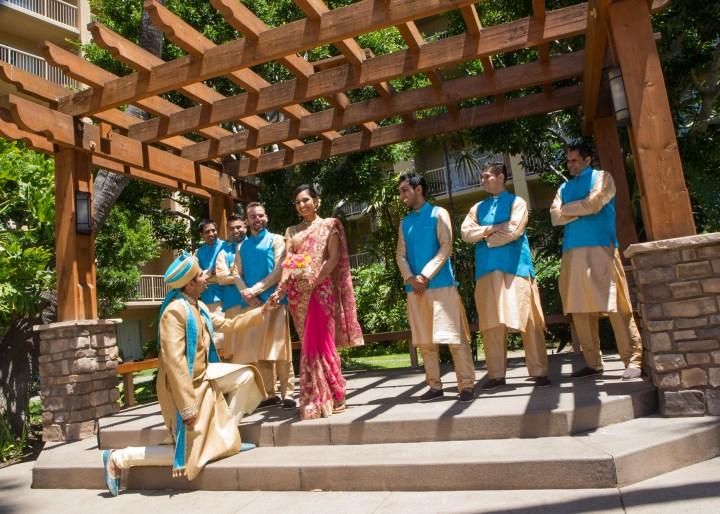 Ashmi-Suraj-Indian-wedding-venue-Hindu-Jain-ceremony-bride-groomsmen-groom-down-on-knee