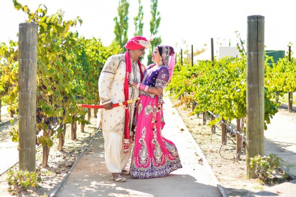 In the field looking @ each otherSonia-Sunny-Indian-wedding-venue