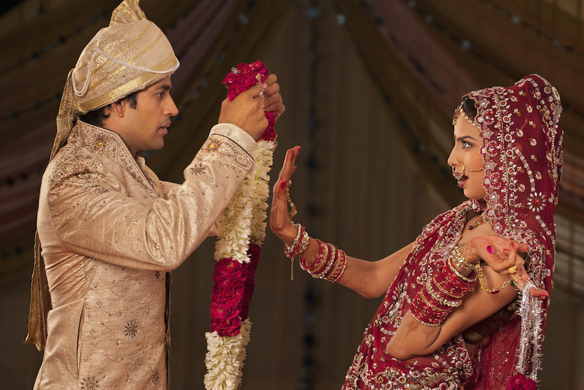 Indian bride stopping the wedding ceremony with her hand up in a symbol to stop