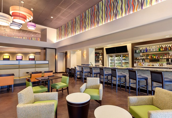 The newly renovated restaurant at the Delta Marriott in Anaheim, California with colorful cushioned sofas and booths.