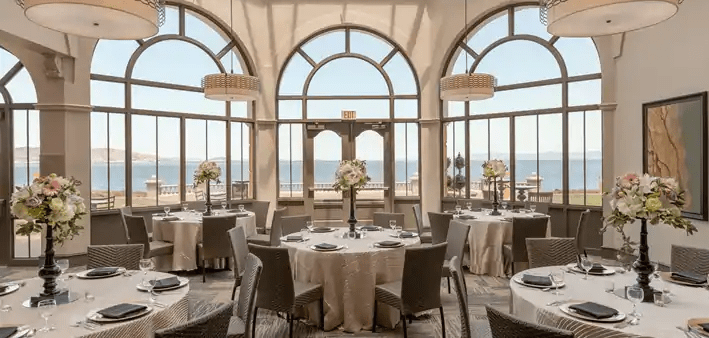 Post ceremony lunch venue with floor-to-ceiling windows at Embassy Suites SFO Waterfront