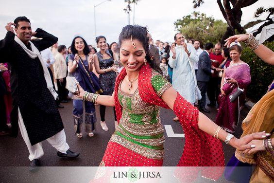 Girl dancing at an Indian wedding baraat