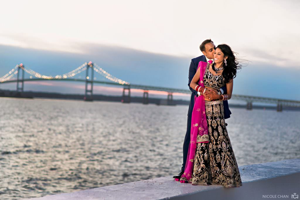 Indian couple posing in their Indian clothes before their wedding reception