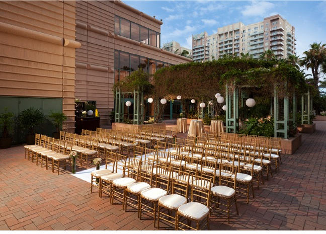 Chiavari chairs setup theater style for an outdoor wedding ceremony at the Westin Long Beach.