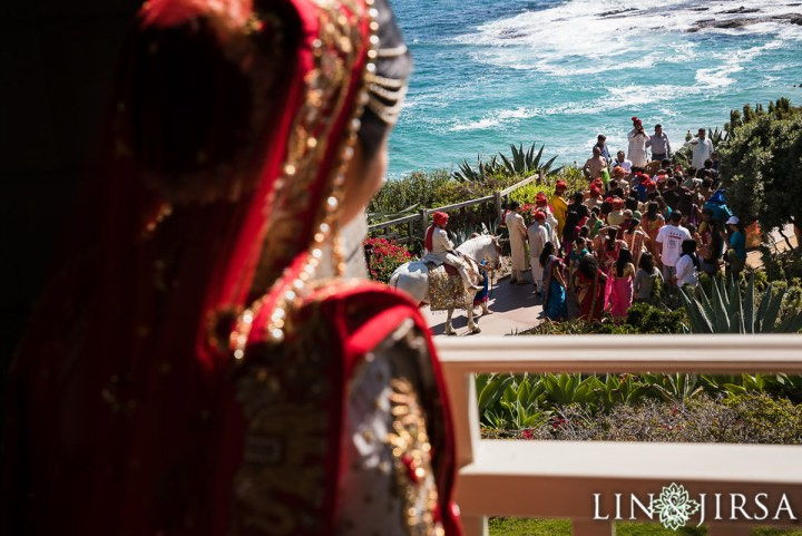 Indian bride watching the baraat an an Indian wedding at the Montage Laguna Beach.