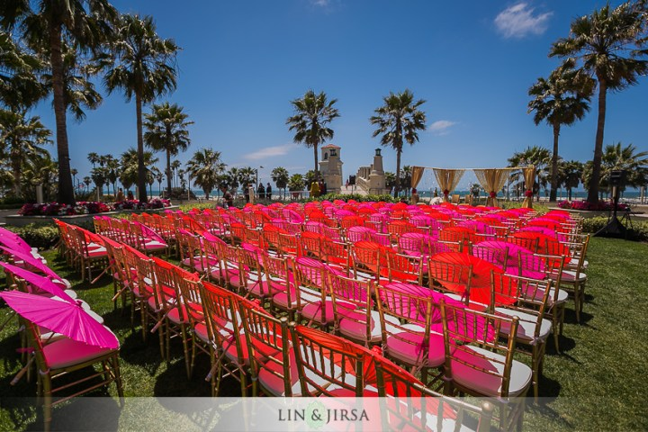 Chiavari chairs with red parasols at an Indian wedding. Selecting Chairs for an Indian Wedding.