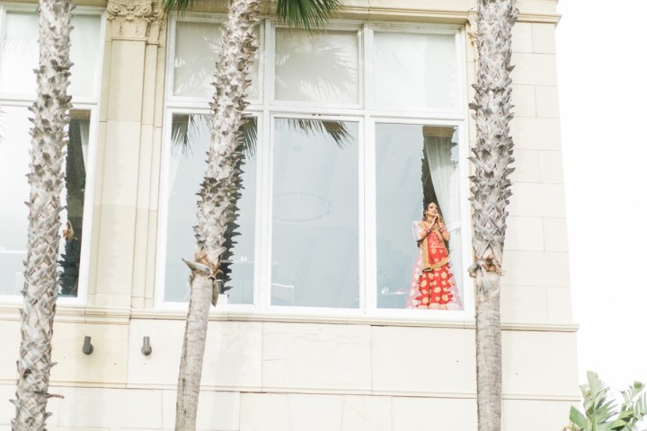 Indian bride looking out the window at the baraat at Casa del Mar