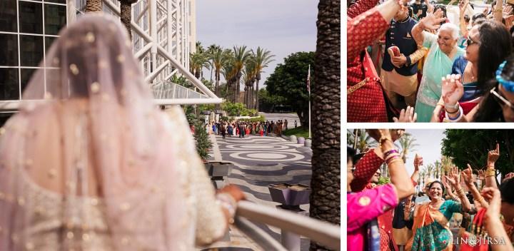 Indian bride standing on balcony watching the baraat at the Hyatt Regency Orange County