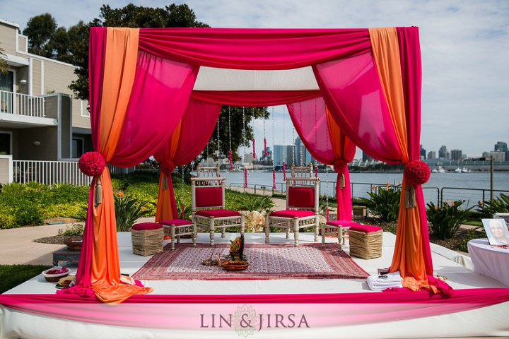 A $50K Budget for an Indian Wedding Buys a draped mandap vs. a mandap heavy with flowers.