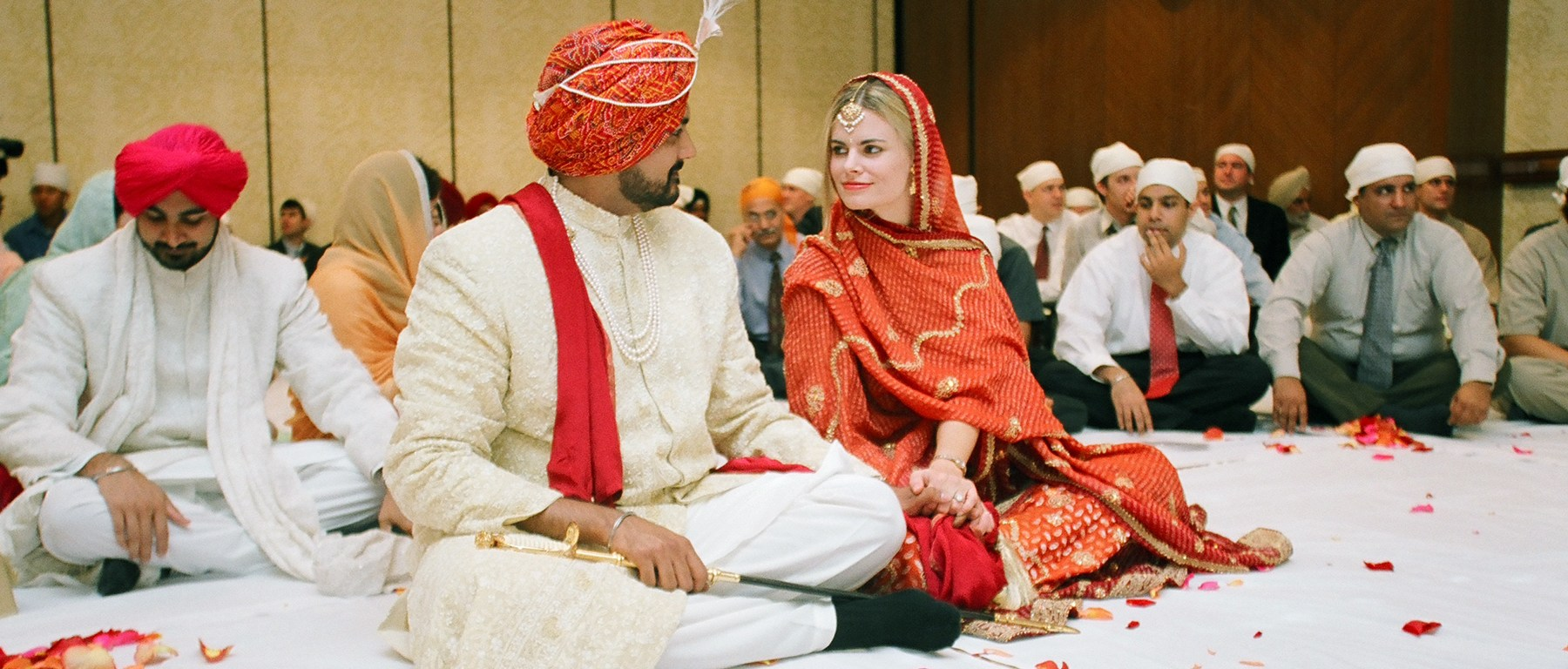 Couple looking at each other at their Anand Karaj