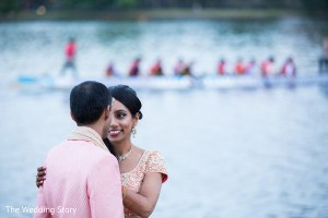 Romantic photo of Indian bride and groom with a crew group on a canoe passing by in the background