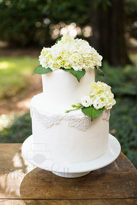 Simple Two-Tiered Cake with a Lace Design from Pastry Shells