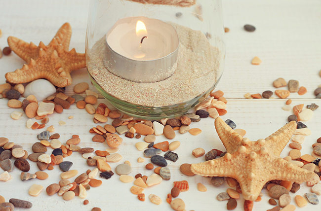 candle centerpiece with sea shells