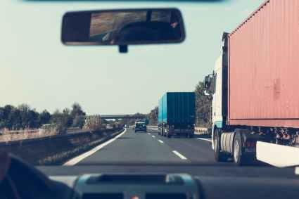 blue and red freight truck on road