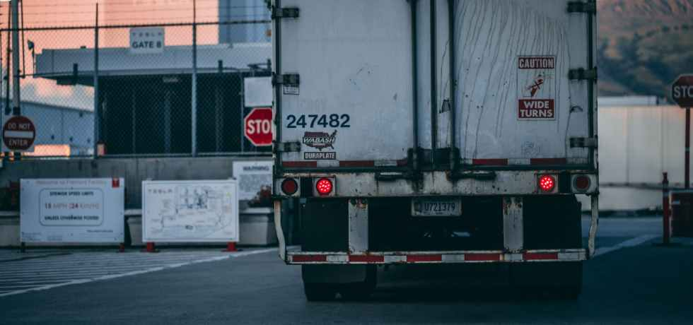 white freight truck close up photography