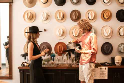 a couple shopping for hats