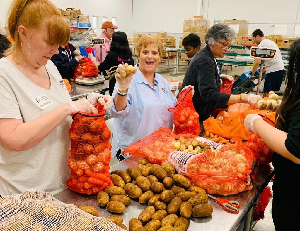 Shop LC Social Works volunteering at the Central Texas Food Bank.