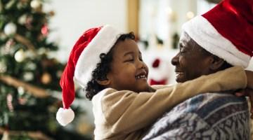 Young boy hugging his grandpa at Christmas