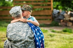 Child greeting military parent.
