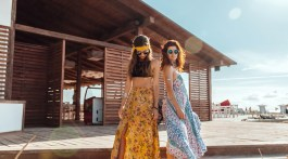 2 women posing with maxi dresses outside in the beach