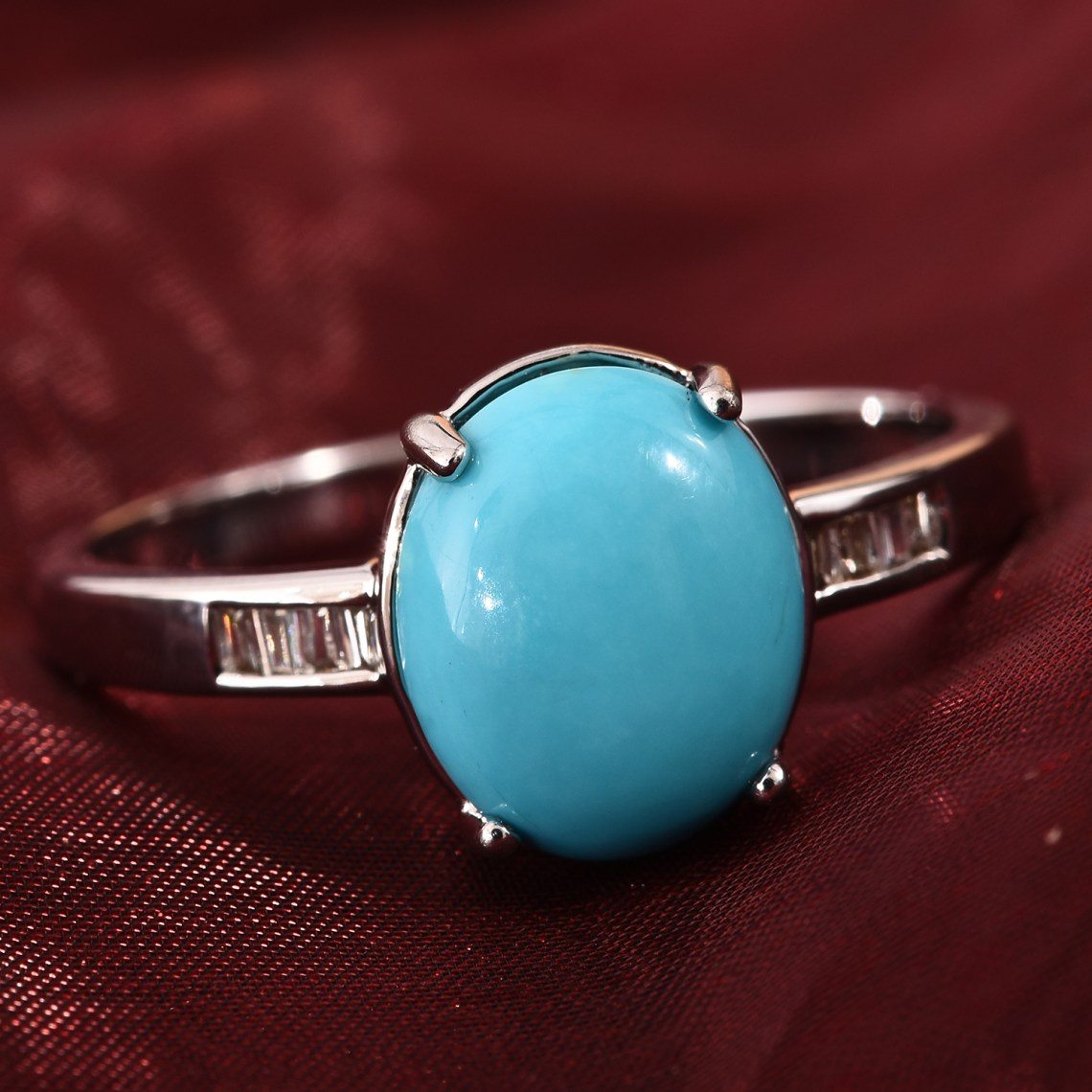 Sleeping Beauty turquoise ring in 18K white gold.