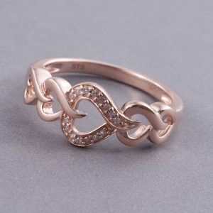 Pink diamond heart ring with 14K rose gold finish.