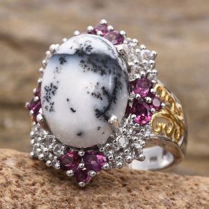 Dendritic agate ring on stone display.