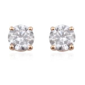Round diamond earrings in 14k yellow gold.