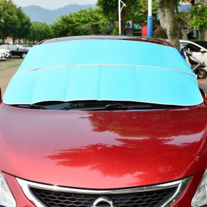 A blue windshield cover protects a vehicle from the sun.