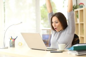 Woman celebrating an online auction win.