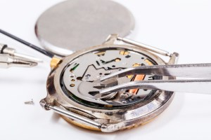 Replacing the battery in a quartz movement watch.
