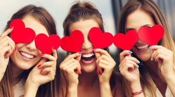 Women celebrating with Galentine's Day gifts!