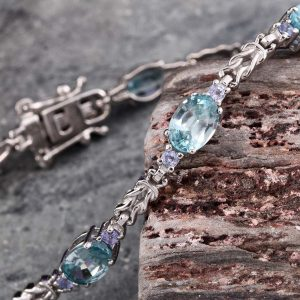 Blue zircon and tanzanite line bracelet in sterling silver.