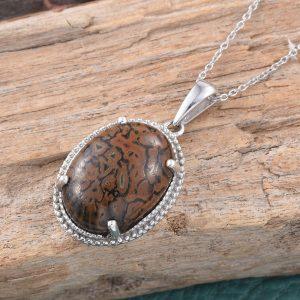 Dino bone gembone pendant in sterling silver.