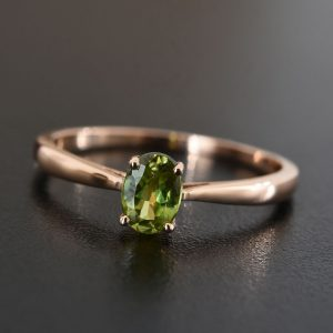 Sphene solitaire ring in sterling silver.