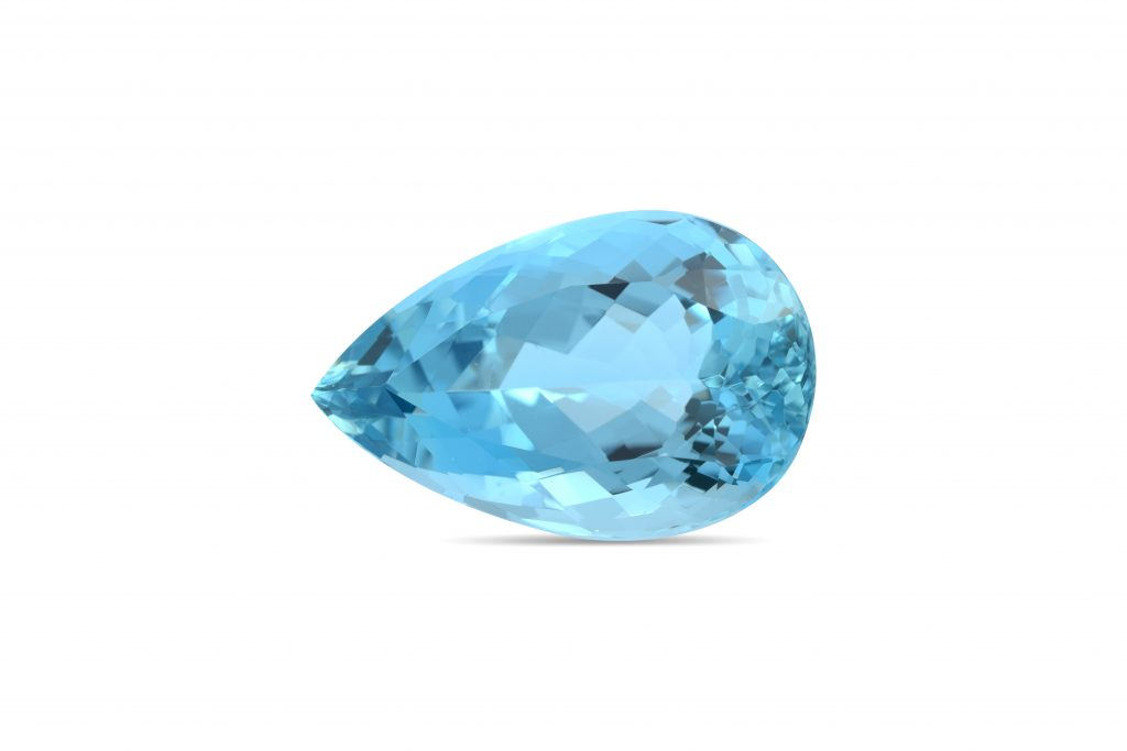 Pear-shaped aquamarine gemstone against white background.