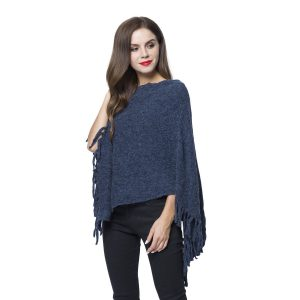 Woman wearing asymmetrical poncho with fringe.