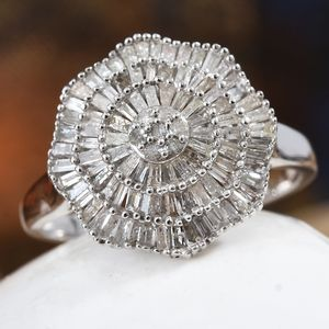 Diamond cluster ring displayed on white rock.