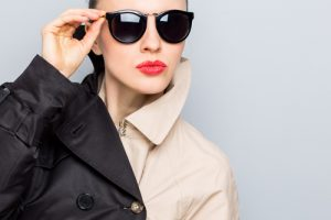 woman wearing contrasting color trench coat