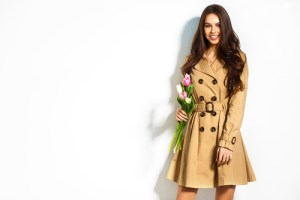woman wearing beige trench coat with flowers