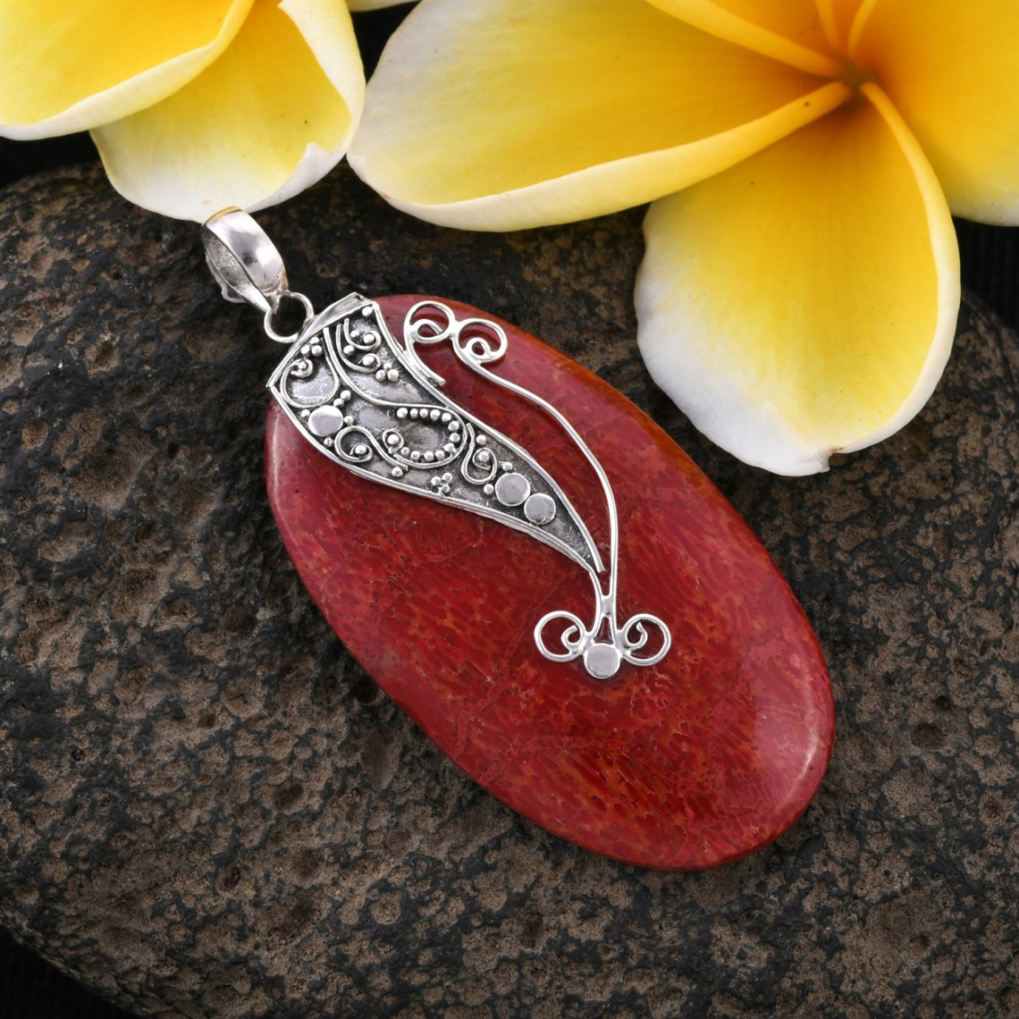 Red coral pendant with sterling silver accents.