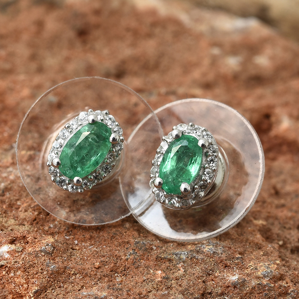 Emerald halo stud earrings.